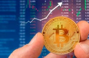 Relatório do FMI destaca queda no PIB global e riscos para o Bitcoin